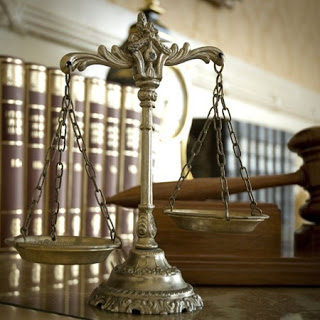 a proposito bilancia-della-giustizia