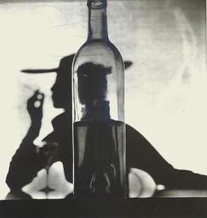 irving-penn-girl-behind-bottle-1949-e1445327282872