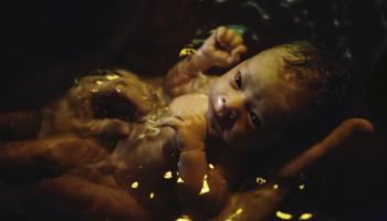 Newborn soaking in birthing pool