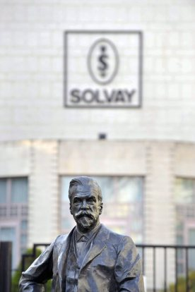 "epa02669508 (FILE) A file photo dated 28 September 2009 shows the statue of chemist Ernest Solvay outside the headquarters of Belgian chemical company Solvay in Brussels, Belgium. Solvay announced Monday that it is seeking to acquire French competitor Rhodia in a 3.4 billion euro (4.8 billion dollar) takeover. The two chemical firms, that have signed a framework agreement and describe the acquisition as ""friendly"", are expected to generate 12 billion euros in combined sales. Solvay handles specialty polymers, soda ash and hydrogen peroxide, employing some 16,800 people in 40 countries. Rhodia, which has some 14,000 employees, focuses on specialty materials such as rare earths along with consumer-market products and engineering plastics. EPA/OLIVIER PAPEGNIES BELGIUM OUT *** Local Caption *** 00000401878247"