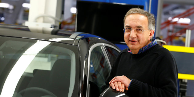 FCA CEO Sergio Marchionne poses next to the new Alfa Romeo car Stelvio during an event at an FCA plant in Cassino
