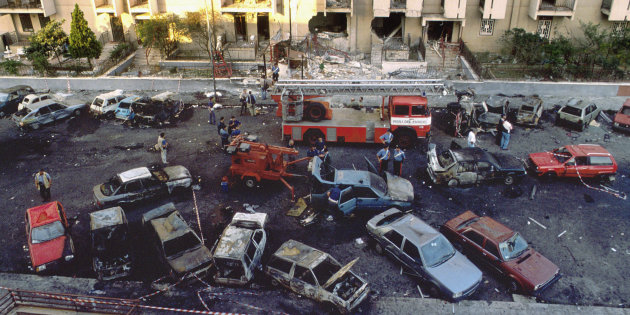 Burned cars are seen the day after a bomb attack that killed judge Paolo Borsellino and his police guards in Palermo