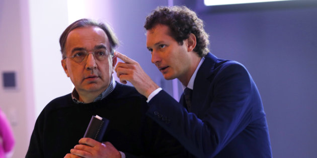 Fiat Chrysler Chief Executive Sergio Marchionne and Fiat Chairman John Elkann enter the auditorium for the FCA Investors Day at Chrysler World Headquarters in Auburn Hills