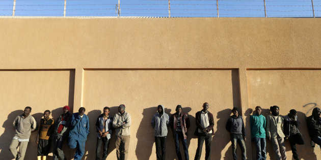 Migrants stand in a detention centre run by the interior ministry of Libya's eastern-based government, in Benghazi
