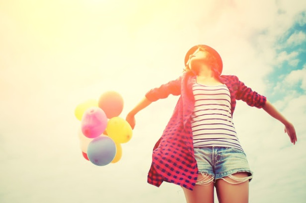 young beautiful woman holding balloon very happy on the fresh air